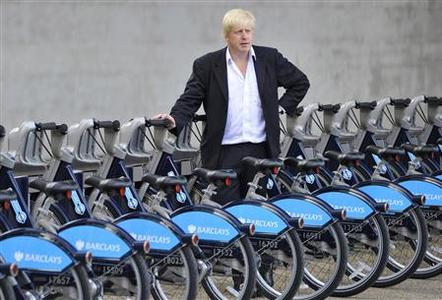 London Mayor Boris Johnson poses for photographers with hire cycles beside the London Eye July 30, 2010. REUTERS/Toby Melville