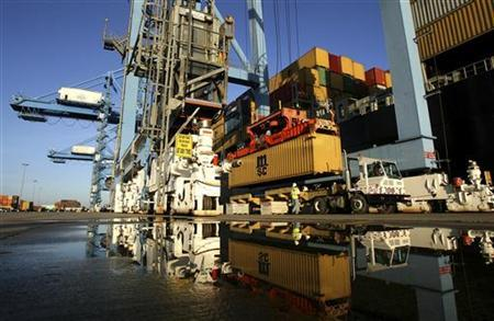 Crews load and unload consumer products at the Port of New Orleans along the Mississippi River in New Orleans, Louisiana in this June 23, 2010 file photo. REUTERS/Sean Gardner