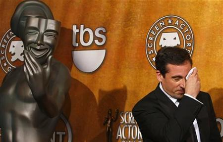 Actor Steve Carrell mops his brow while he holds his award for best ensemble comedy for ''The Office'' while backstage at the 14th annual Screen Actors Guild Awards in Los Angeles January 27, 2008. REUTERS/Mike Blake