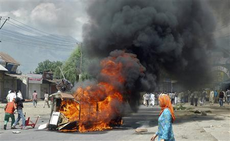 Kashmiri protesters set ablaze a government vehicle after the death of two people in police firing in Pampore on the outskirts of Srinagar August 1, 2010. Two people were killed on Sunday bringing the death toll to 8 since Friday by police firing on Kashmiri protesters during angry anti-India demonstrations in Indian-administered Kashmir, police and witnesses said. REUTERS/Stringer