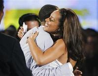 <p>Singer Alicia Keys hugs her fiance Swizz Beatz after winning the Best Female R&B Artist award at the 2010 BET Awards in Los Angeles June 27, 2010. REUTERS/Mario Anzuoni</p>
