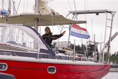 <p>Laura Dekker of the Netherlands waves to well wishers as she sails her boat Guppy out of the harbour of Den Osse August 4, 2010. REUTERS/Michael Kooren</p>