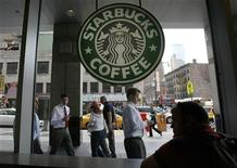 <p>People walk past the Starbucks outlet on 47th and 8th Avenue in New York June 29, 2010. REUTERS/Lily Bowers</p>