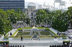 <p>Doves fly over the Peace Memorial Park with a view of the gutted A-bomb dome at a ceremony in Hiroshima August 6, 2010, to mark the 65th anniversary of the atomic bombing on the city. REUTERS/Kyodo</p>