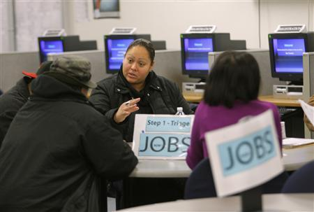 Case worker Jessica Yon discusses eligibility for unemployed people at a jobs center in San Francisco, California in this February 4, 2010 file photo. REUTERS/Robert Galbraith/Files