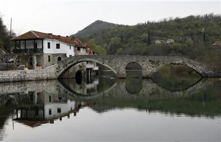 A bridge built in 1853 is seen in the town of Rijeka Crnojevica, Montenegro, April 4, 2008. REUTERS/Ivan Milutinovic