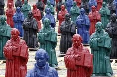 <p>Plastic statuettes of 16th-century Protestant reformer Martin Luther, which are part of the art installation 'Martin Luther - I'm standing here' by German artist Ottmar Hoerl, are pictured in the main square in Wittenberg, eastern Germany August 11, 2010. REUTERS/Fabrizio Bensch</p>