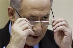 <p>Israel's Prime Minister Benjamin Netanyahu attends the weekly cabinet meeting at his office in Jerusalem August 8, 2010. REUTERS/Oliver Weiken/Pool</p>