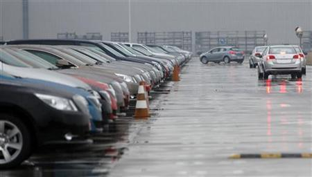 New cars are seen at a parking lot of GM car park in Shanghai January 11, 2010. REUTERS/Aly Song