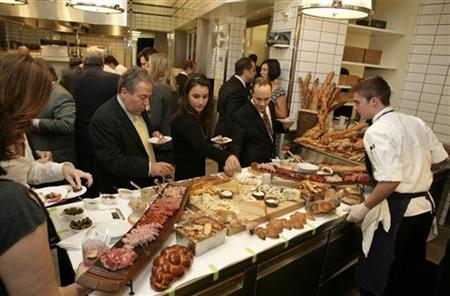 Attendees of the March of Dimes Gourmet Gala sample foods in the kitchen of the Per Se restaurant in New York in this November 6, 2007 file photo. REUTERS/Nicholas Roberts