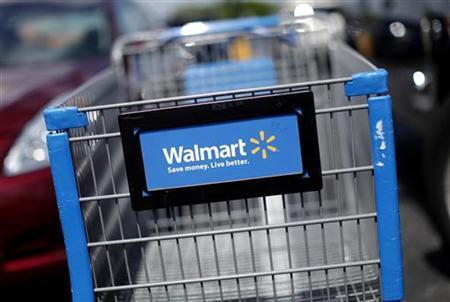 A Wal-Mart cart is seen at the parking lot of a Wal-Mart market in Miami, Florida May18, 2010. REUTERS/Carlos Barria