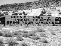 <p>An Arizona sign after an apostrophe urging tourists to bring their camera's was removed. REUTERS/Jeff Deck</p>