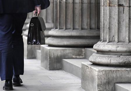 A businessman walks past the Bank of England in central London January 16, 2009. REUTERS/Toby Melville
