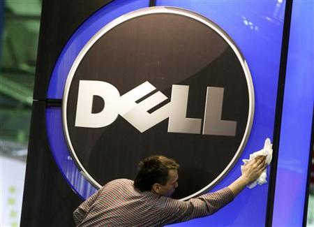 A man wipes the logo of Dell at the CeBIT fair in Hannover, February 28, 2010. REUTERS/Thomas Peter