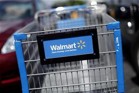 A Wal-Mart cart is seen at the parking lot of a Wal-Mart market in Miami, May 18, 2010. REUTERS/Carlos Barria