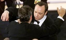 "<p>Kevin Spacey (R) hugs director Sam Mendes after winning the Oscar for Best Actor for his roll in the movie ""American Beauty,"" at the 72nd Annual Academy Awards March 26, 2000. REUTERS/Gary Hershorn</p>"