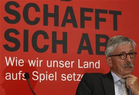 German central bank executive Thilo Sarrazin attends the presentation of his book 'Deutschland schafft sich ab' (Germany does away with itself) in central Berlin, August 30, 2010. REUTERS/Fabrizio Bensch