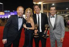 "<p>Cast members of ""Modern Family"", (L-R) Jesse Tyler Ferguson, Julie Bowen, executive producer Steven Levitan and Ty Burrell, pose outside the Governor's Ball after the show won for outstanding comedy series, following the 62nd annual Primetime Emmy Awards in Los Angeles, California, August 29, 2010. REUTERS/Mario Anzuoni</p>"