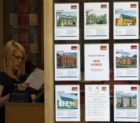 A woman works in an estate agents office in Leicester, central England, August 10, 2010. REUTERS/Darren Staples