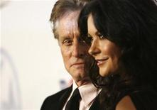 <p>Actor Michael Douglas looks at his wife actress Catherine Zeta-Jones at the 20th annual Producers Guild Awards at The Hollywood Palladium in Los Angeles January 24, 2009. REUTERS/Mario Anzuoni</p>