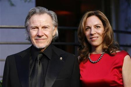 Actor Harvey Keitel and wife Daphna Kastner arrive at the 2010 Vanity Fair Oscar party in West Hollywood, California March 7, 2010. REUTERS/Danny Moloshok