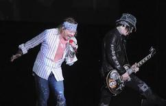 <p>Axl Rose (L), lead singer of the U.S. band Guns N' Roses, and a guitarist of the band perform during the Chinese Democracy World Tour 2010 in Montevideo March 18, 2010. REUTERS/Patricia Torres</p>