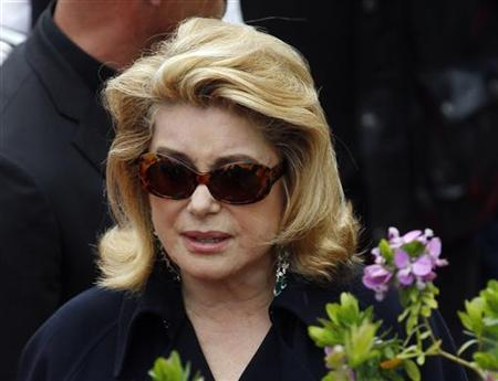 French actress Catherine Deneuve leaves a photocall for a tribute to Spanish cinema at the 63rd Cannes Film Festival May 15, 2010. REUTERS/Yves Herman
