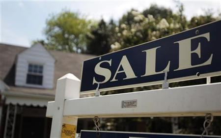 A 'sale' sign is seen outside a house in Alexandria, Virginia, July 22, 2010. REUTERS/Molly Riley