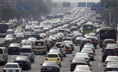 Cars are seen in a traffic jam in the second ring road in Beijing September 9, 2010. REUTERS/Petar Kujundzic