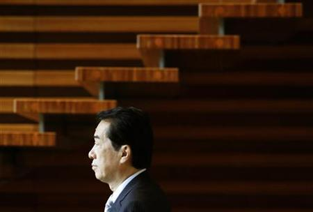 Japan's Prime Minister Naoto Kan walks past a staircase at his official residence in Tokyo August 30, 2010. REUTERS/Yuriko Nakao
