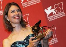 """<p>Sophia Coppola, director of """"Somewhere"""" receives the Golden Lion for Best Film during the closing ceremony of the 67th Venice Film Festival September 11, 2010. REUTERS/Alessandro Bianchi</p>"""