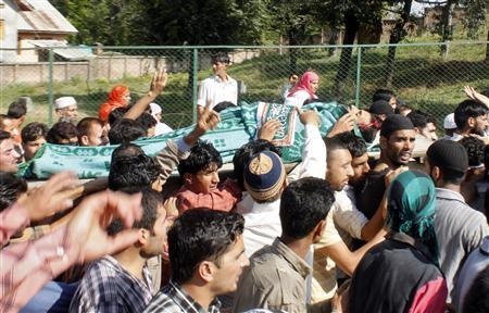 People carry the body of Nisar Ahamad Kuchay, a Kashmiri youth, during his funeral in Humhama on the outskirts of Srinagar, September 13, 2010. REUTERS/Stringer