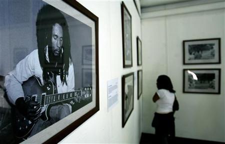 An Ethiopian reggae fan looks at photographs of Bob Marley at an exhibition in Ethiopia's capital Addis Ababa, February 4, 2005. REUTERS/Antony Njuguna