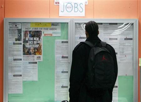 A man looks over employment opportunities at a jobs center in San Francisco, California, in this February 4, 2010 file photo. REUTERS/Robert Galbraith/Files