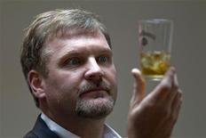<p>Jeff Arnett, master distiller at the Jack Daniel's distillery, looks at a glass of whiskey as he poses during an interview with Reuters in Paris September 9, 2010. REUTERS/Charles Platiau</p>