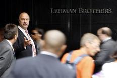 <p>People walk past the Lehman Brothers headquarters in New York September in this September 16, 2008 file photo. REUTERS/Chip East/Files</p>
