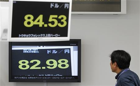 A foreign exchange broker watches a television (bottom) showing the Japanese yen's exchange rate against the U.S. dollar before the Finance Ministry intervened in the currency market while the current rate flashes above him in Tokyo September 15, 2010. Japan intervened in the currency market on Wednesday for the first time in six years, selling yen to stem a rise in the currency that is threatening a fragile economic recovery. REUTERS/Yuriko Nakao