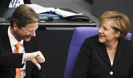 <p>German Chancellor Angela Merkel listens to Foreign Minister Guido Westerwelle at the meeting of the Bundestag lower house of parliament in Berlin, September 15, 2010. REUTERS/Tobias Schwarz</p>