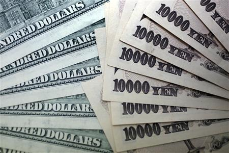 Japanese 10,000 yen notes are spread out next to U.S. 100 dollar bills at an Interbank Inc. money exchange office in Tokyo, in this September 9, 2010 file photo picture illustration. REUTERS/Yuriko Nakao