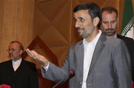 Iran's President Mahmoud Ahmadinejad arrives at a meeting with Arab and foreign ambassadors in Doha September 5, 2010. Iranian Foreign Minister Manouchehr Mottaki is pictured at left. REUTERS/Stringer