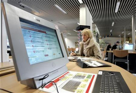 A woman uses a computer in a Federal Labour Office job centre in the western German town of Essen. REUTERS/Kirsten Neumann