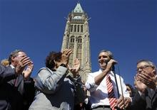 <p>Liberal leader Michael Ignatieff (2nd R) is applauded by his caucus while delivering a speech on Parliament Hill in Ottawa September 20, 2010.</p>