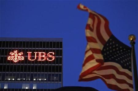 An U.S. flag flies in front of a UBS building in New York November 17, 2009. REUTERS/Lucas Jackson