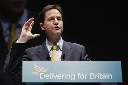 Deputy Prime Minister Nick Clegg, the leader of the Liberal Democrat Party, gestures as he delivers his speech at his party's conference in Liverpool, northern England, September 20, 2010. REUTERS/Phil Noble