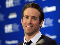 "<p>Canadian actor Ryan Reynolds smiles during a news conference for the film '""Buried"" at the 35th Toronto International Film Festival September 13, 2010. REUTERS/Mike Cassese</p>"