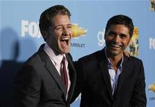 "<p>Cast members Matthew Morrison (L) and John Stamos smile at the premiere of the second season of the television series ""Glee"" at Paramount studios in Los Angeles September 7, 2010. REUTERS/Mario Anzuoni</p>"