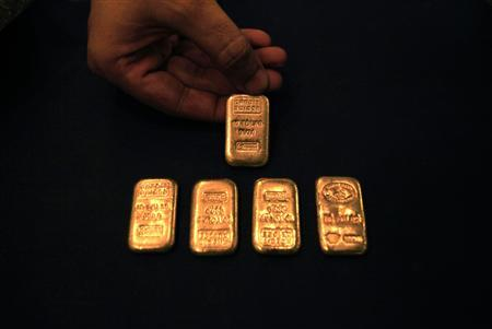 A jeweller displays gold ingots at his shop in Peshawar, northwest Pakistan on September 23, 2010. REUTERS/Fayaz Aziz