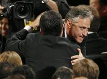 "<p>Jon Stewart hugs Stephen Colbert (back facing camera) after winning best variety music or comedy series for ""The Daily Show with Jon Stewart"" at the 61st annual Primetime Emmy Awards in Los Angeles, California in this September 20, 2009 file photo. REUTERS/Mario Anzuoni</p>"