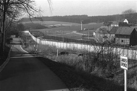 A general view, taken from Western Germany shows the wall and watch tower at the former East German border in the village of Moedlareuth, about 300 kilometres (186 miles) south of Berlin, March 12, 1978. The Wall in the village of Moedlareuth, separating East from West Germany, was built in 1966. It was 700 meters long and 3.40 meters high, heavily guarded round the clock by East German border police and divided the village till the Wall came down in 1989. During this time Moedlareuth was also known as ''Little Berlin''. REUTERS/Handout/Bayrische Grenzpolizei/Mediathek des Deutsch-Deutschen Museum Moedlareuth