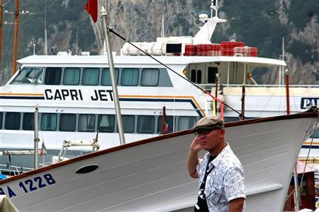 A Japanese stands on the quay on Capri island, southern Italy. REUTERS/Stringer/Files
